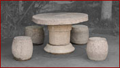 round stone table and stools